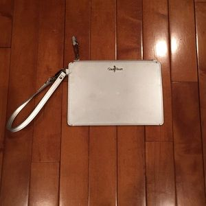 Used condition Cole Haan clutch in silver